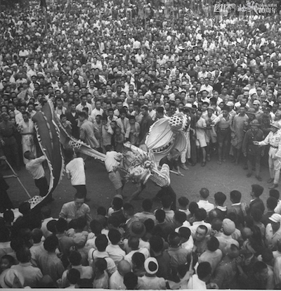Chinese crowds celebrating surrender of Japan on VJ Day, with some performing the Dragon Dance.  (Photo by Jack Wilkes/The LIFE Picture Collection/Getty Images)