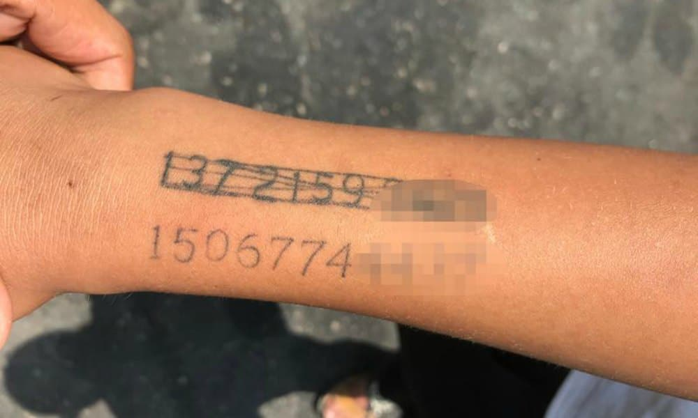 Permanent Number Chinese Mother Tattoos Phone Number On Sons Arm